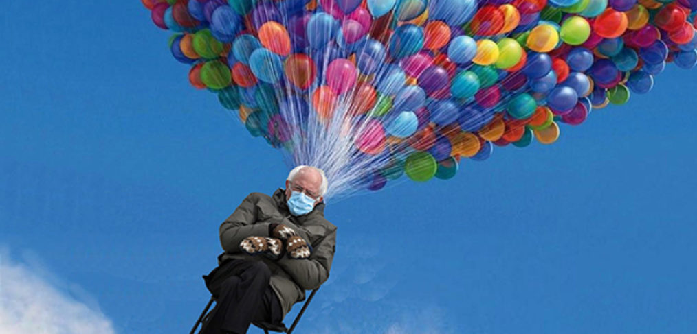 photo of Bernie Sanders wearing mittens seated in a chair being lifted up into blue sky by huge bunch of multicolored balloons